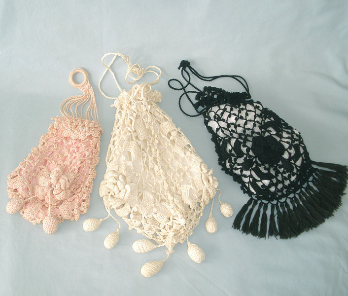 Drawstring purses crocheted by Susan Veronicia (Lukens) Keating.