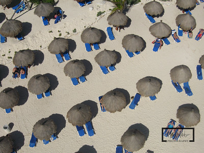 Gran Bahia Akumal Kite Aerial Photography Photos looking down over beach cabanas.  © Copyright m2 Photography - Michael J. Mikkelson 2009. All Rights Reserved. Images can not be used without permission.