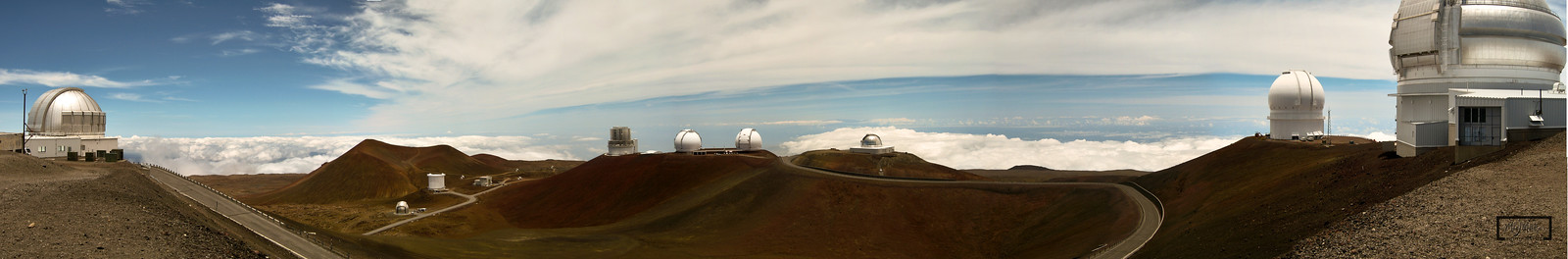 This was taken near the summit of Mauna Kea, looking at a number of the observatories which are an independent collection of astronomical research facilities on the Big Island of Hawai'i.  Some of these are public and allow visitors to use the equipment.  © Copyright m2 Photography - Michael J. Mikkelson 2009. All Rights Reserved. Images can not be used without permission.