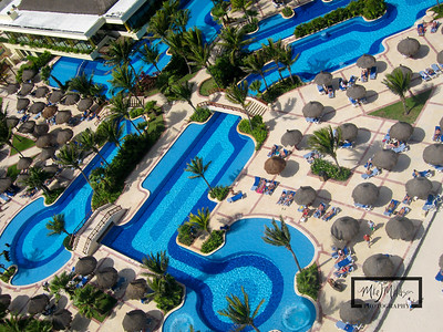 Gran Bahia Akumal Kite Aerial Photography Photos looking down at sunbathers and pool.  © Copyright m2 Photography - Michael J. Mikkelson 2009. All Rights Reserved. Images can not be used without permission.