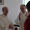 Fr. Fernando gets a few words in prior to Mass