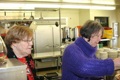 Gladys and Ann working their magic in the kitchen