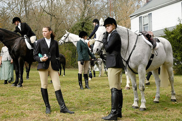 Young lady riders with their horses at the blessing of the fox hunting hounds, horses, and riders at the Iroquios Hunt Club in Lexington, Kentucky USA. The event marks the beginning of the hunting season,