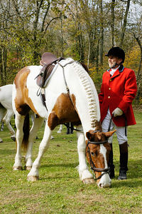 Fox hunter at the blessing of the fox hunting hounds, horses, and riders at the Iroquios Hunt Club in Lexington, Kentucky USA. The event marks the beginning of the hunting season and follows the tradition of honoring Saint Hubert, the patron saint of hunters.