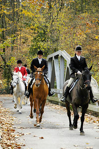 Mounted riders on way to the first fox hunt of the season.  Iroquois Hunt Club in Lexington, Kentucky, USA.