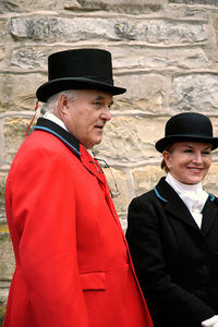 Smartly dressed fox hunters waiting in line for the blessing of the riders during the annual Blessing of the Hounds event at the Iroquois Hunt Club in Lexington, Kentucky, USA