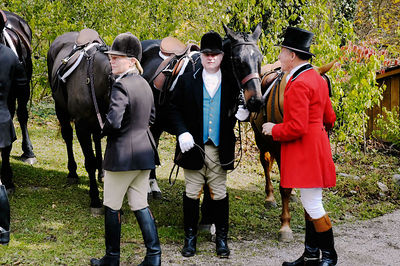 Fox hunters at the blessing of the fox hunting hounds, horses, and riders at the Iroquios Hunt Club in Lexington, Kentucky USA. The event marks the beginning of the hunting season and follows the tradition of honoring Saint Hubert, the patron saint of hunters.
