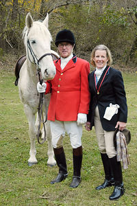 Fox hunter couple at the blessing of the fox hunting hounds, horses, and riders at the Iroquios Hunt Club in Lexington, Kentucky USA. The event marks the beginning of the hunting season .