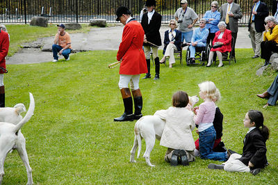 Children petting a hound at the annual blessing of the fox hunting hounds, horses, and riders at the Iroquios Hunt Club in Lexington, Kentucky USA. The event marks the beginning of the hunting season.