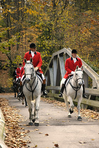 Mounted huntsmen crossing a bridge on the way to the first foxhunt of the season at the Iroquois Hunt Club following the Blessing of the Hounds.