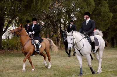Mounted riders on way to the first fox hunt of the season.  Iroquois Hunt Club in Lexington, Kentucky, USA