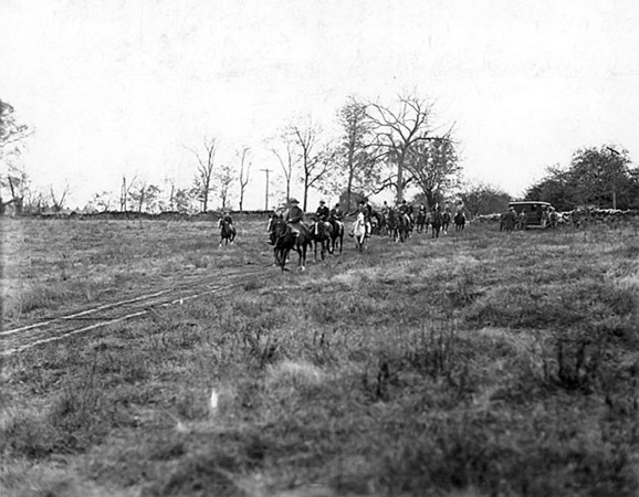 Title: Fayette County, Kentucky. Iroquois Hunt Club scene, Grimes Mill. President L.B. Shouse in the lead. Date: 1900-1954 Collection: C. Frank Dunn Photographs Collection, 1900-1954, bulk 1920-1940