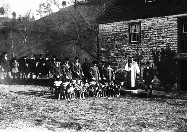 Title: Blessing of the Hounds at Grimes Mill, November 18, 1933. The Iroquois Hunt and Polo Club opened its hunting season with the Blessing of the Hounds Ceremony. In 1933, the ceremony was conducted by the Rt. Rev. H. P. Almon Abbott, bishop of the Lexington Episcopal diocese, who had officiated at the Club's inaugural Blessing of the Hounds ceremony the previous year. Named for Iroquois, the first American horse to win the English Derby, the Iroquois Hunt Club was founded in the early 1880s. (1670) Date: 1933 Collection: Selected Images of Lexington, 1930-1950 Creator: Lafayette Studios