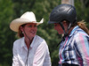 Missy Wilson and Emily Dery kill some time while  tractor problems get sorted out.  4-D BARRELS 2nd Run and EXHIBITION RUNS on Sat. July 10, 2010