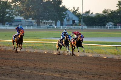 Stock image of horses racing at the annual quarter horse races at the Red Mile track in Lexington, Kentucky, USA