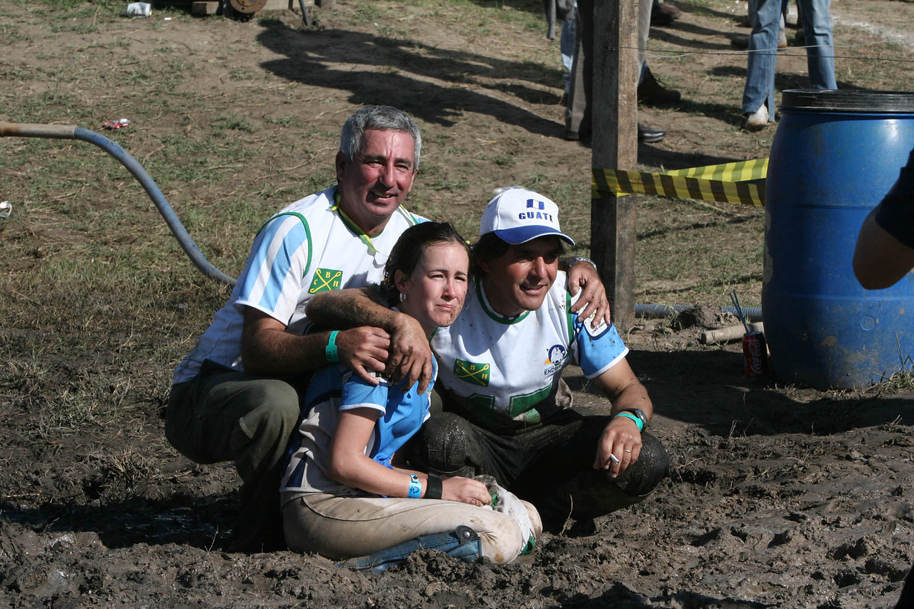 Young Rider Gold Medal winner, Laua Paiz was dumped in the mud ...seated with trainer, and father
