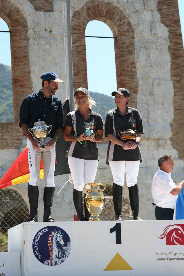 6. 0091  Gold medal Podium...Silver, left, Bronze, right