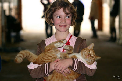 Madison and a happy cat.