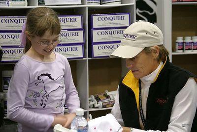 Anne Kursinski signs Natalie's hat.