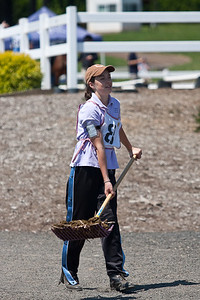 Cassie hard at work picking up after horses.
