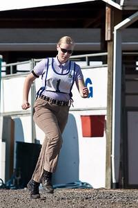 Sarah sprints towards the barn.