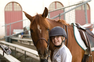 Memo and Natalie wait for a turn in the warmup ring.