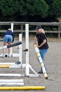 Paris the horsemom helps set jumps.