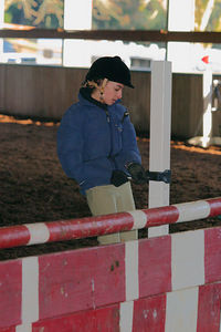 Alexandra raises jump rails