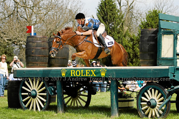 """HEATH RYAN on FLAME in the Cross Country phase of the Rolex Three-Day CCI**** Event falling at the Drake. Flame jumped right up and appeared sound, but Heath required medical attention. From Poulsen Photography and Troutstreaming Outdoor and Sports Media on location coverage of the 2007 Rolex Three Day Event from Saturday April 28th at the Kentucky Horse Park in Lexington Kentucky. All content Copyright 2007 J Andrew Towell. To purchase images from the event please visit  <a href=""""http://www.poulsenphoto.com"""">http://www.poulsenphoto.com</a> or contact the copyright holder."""