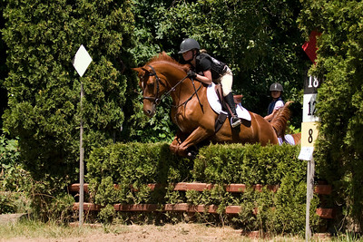 Natalie and Memo over the hedge on the cross country course.