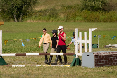 Cassie, Natalie and Elise walk the show jumping course.