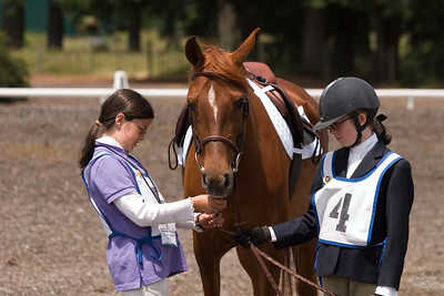 Stable Manager Cassie helps Natalie prepare for formal inspection.