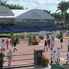 WEST PALM BEACH, FLORIDA - March 30, 2018: Competitors and trainers and owners walk the course before a large competition at week 12 of the Winter Equestrian Festival in Florida