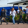 WEST PALM BEACH, FLORIDA - January 13, 2018: a group of competitors and trainers walking the course at week 1 of the Winter Equestrian Festival in Wellington, Florida