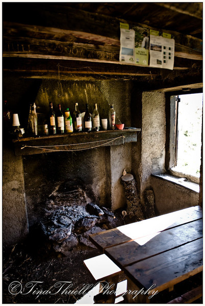 Inside the hut was all you needed.  A fire, a table, some hard liquor and above was a flat plank where you could sleep.  Pretty cozy don't you think?