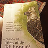 "If you are going to buy one book on Philippine Birds buy this one. It is the bible of the Philippine birders. A Guide to the Birds of the Philippines by Robert S. Kennedy, Pedro C. Gonzales, Edward C. Dickinson, Hector C. Miranda Jr., and Timothy H. Fisher. It is usually just called the Kennedy Guide. It is printed by the Oxford University Press and was first published in the year 2000. There is a hardbound version and a soft cover version. <br /> <br /> This is the best field guide for Philippine Birds. Its is a resource that is meant to be a birders companion. The picture above is our copy of this great book. We bring it on all our trips. It has travelled by jet plane, propeller plane, boat, car, jeep, tricycle, horse and it has also done its share of hiking. Its a bit bent, dirty, and battered. But it is more or less intact and in slightly better condition compared to the more abused copies we have encountered. Some of our friend's field guides are stapled together, bound by duct tape, xeroxed, laminated and basically subjected to all forms of Frankenstein book binding to keep their tomes in one piece. A Philippine birder usually feels slightly naked without a Kennedy Guide nearby. This book is meant to be by your side at all times. Its not meant to be in a book shelf. It is supposed to be a readily available resource to be whipped out at a moments notice. <br /> <br /> The members of the two biggest birding associations in the Philippines rely on this field guide. The Wild Bird Club of the Philippines and the Philippine Bird Photographers Forum members use this book. <br /> <br /> The first part of the book consists of drawings of birds arranged in pages called plates. There are 72 plates.  The birds are arranged in taxonomical order. When you find the bird after looking thru the plates you can get more information by going to the next part of the book. The second part of the book is around 368 pages. It describes the birds in greater detail. You get to know the size, call, range, color and different races of the birds. <br /> <br /> It is not easy to find this book in the Philippines. Sometimes you can find it in Fully Booked. Locally the price ranges around P4,000 sometimes a bit less.  We got ours from Amazon.com. The cost of the book in Amazon is $85.00. You might be able to get it cheaper from the other sellers (around $64) in Amazon or by buying it used in Amazon (around $48).  It is available in Book Depository  <a href=""http://www.bookdepository.com"">http://www.bookdepository.com</a>)  for US$56.52 including free shipping to the Philippines. It is not cheap. But if you are interested in Philippine birds. Bite the bullet. Get this book.<br /> <br /> You can buy other books on birds in the future to augment your field guide. We have bookshelves full of other books. But this book is so well used it does not go back into the shelves. It usually stays on our bedside table. <br /> <br /> For a beginner this book is the portal to great adventures. Get a pair of binoculars. Then walk to a tree with birds flying around it.  Look for a bird then search for it in the book. Repeat. <br /> <br /> Pretty soon you might find yourself in a Palawan forest, looking up a tree trying to get a good look at a Palawan Hornbill.  You could find yourself deep in the Sierra Madre Mountain Range looking for the beautiful Whiskered Pitta. Or you could be drinking coffee in your house looking at a Philippine Pygmy Woodpecker having its breakfast on one of the trees in your garden."
