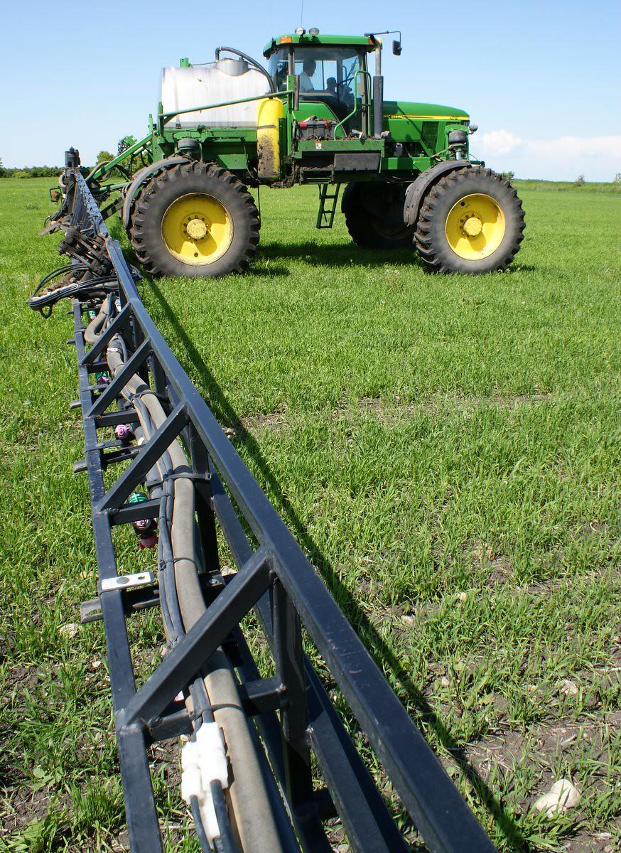 Deere sprayer paused in field