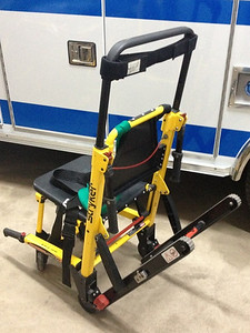 Mid 2000's-current - Stryker stair chair with treads used for carrying patients to the ambulance, particularly up and down stairs.