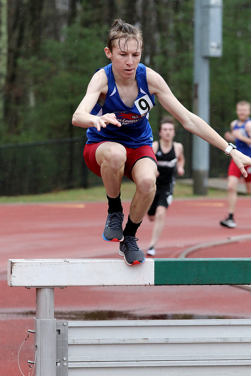 . Eric Loeschner Memorial Invitational Saturday, April 20, 2019 at Fitchburg State University\'s Elliot Field Athletic Complex. UMASS Lowell\'s Zach Mizioch competes in the steeple chase during the meet. SENTINEL & ENTERPRISE/JOHN LOVE