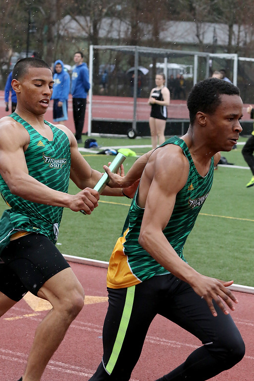 . Eric Loeschner Memorial Invitational Saturday, April 20, 2019 at Fitchburg State University\'s Elliot Field Athletic Complex. FSU\'s Asante Monteiro hands the baton to his teammate Zachary Joseph during the 4x100 at the meet. SENTINEL & ENTERPRISE/JOHN LOVE