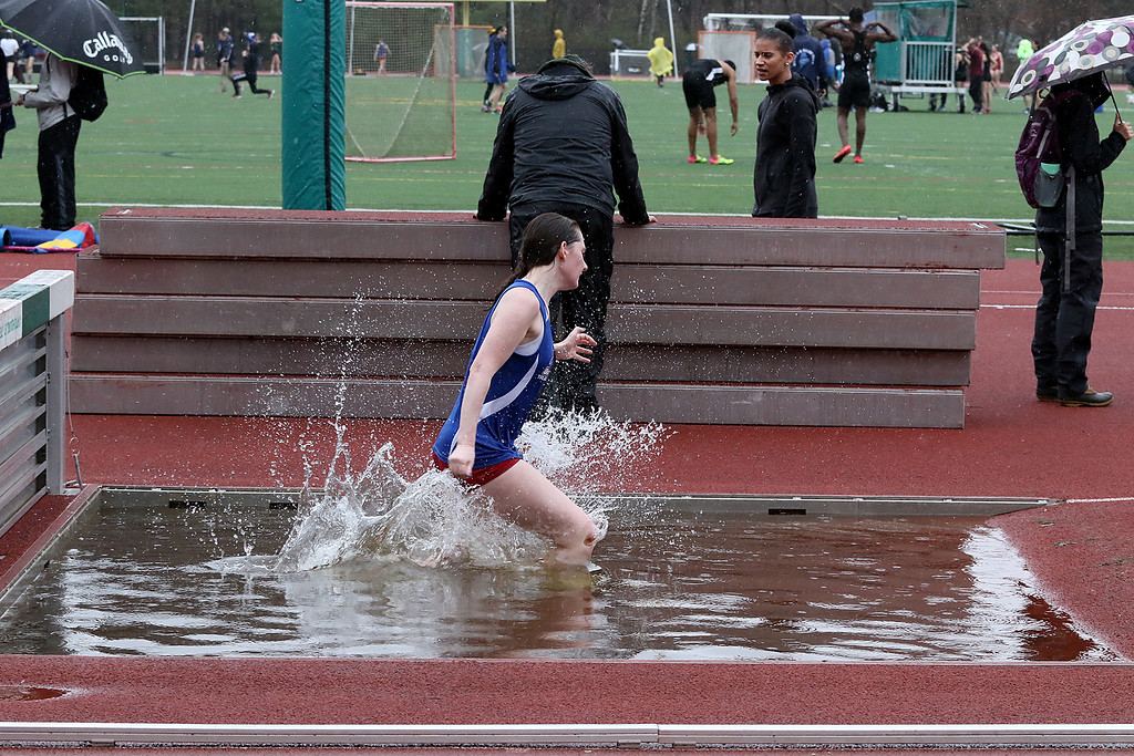 . Eric Loeschner Memorial Invitational Saturday, April 20, 2019 at Fitchburg State University\'s Elliot Field Athletic Complex. UMass Lowell\'s Caroline Bisio competes in the steeple chase during the meet. SENTINEL & ENTERPRISE/JOHN LOVE
