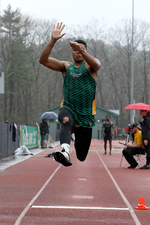 . Eric Loeschner Memorial Invitational Saturday, April 20, 2019 at Fitchburg State University\'s Elliot Field Athletic Complex. FSU\'s Brandon McNeil competes in the long jump during the meet. SENTINEL & ENTERPRISE/JOHN LOVE
