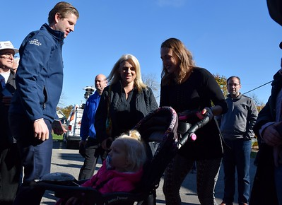 Eric Trump (center), son of Republican presidential candidate Donald Trump, meets with the crowd after his speech at the Grace Centers of Hope William A. Davis Women and Children's Center on Friday, Nov. 4, 2016.