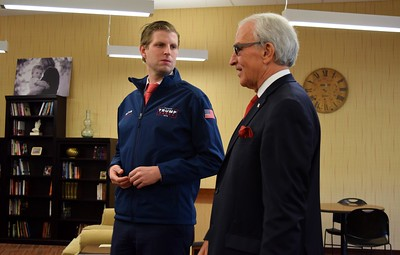 Eric Trump (left), son of Republican presidential candidate Donald Trump, tours the Grace Centers of Hope William A. Davis Women and Children's Center with Pastor Kent Clark, CEO of Grace Centers of Hope, on Friday, Nov. 4, 2016.