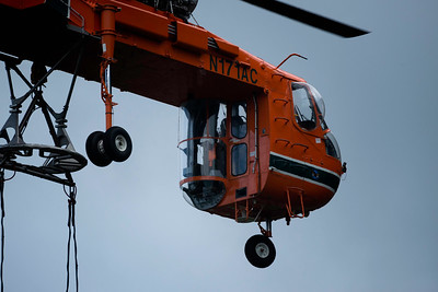 The pilot in the back has the job of making sure the Air-Crane is where it should be for each lift.
