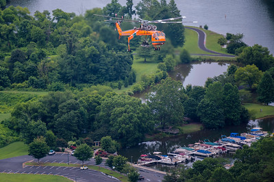 The Air-Crane approaches the LZ with Lake Lure in the background