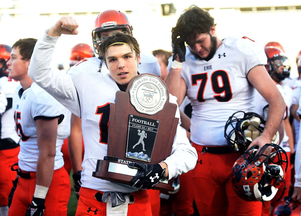 . Jacob Mansdorfer, of Erie, Holds the 3A runner-up Trophy. The Erie High School Tigers lost to Palmer Ridge at the 3A State Championship game.  Cliff Grassmick / Staff Photographer/ December 2, 2017, 2017