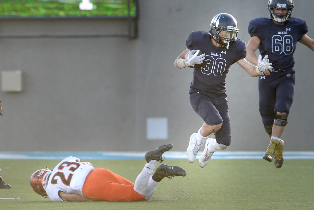 . Rael Ruel, of Palmer Ridge, hops out of the tackle of Nathan Hahn, of Erie. The Erie High School Tigers lost to Palmer Ridge at the 3A State Championship game.  Cliff Grassmick / Staff Photographer/ December 2, 2017, 2017