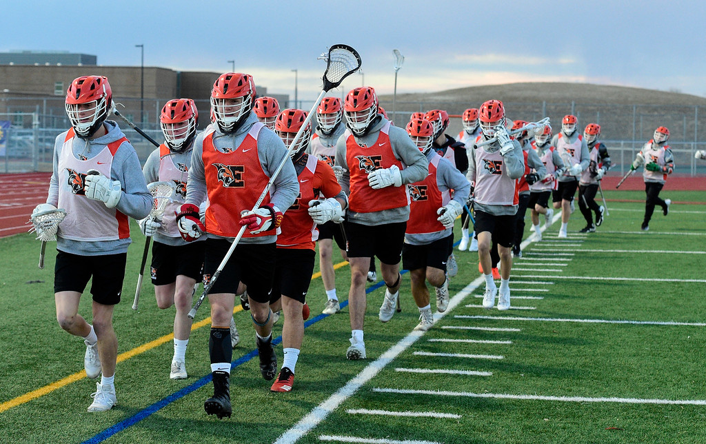 . ERIE CO: February 28, 2019:  The Erie Tigers warm up during Erie lacrosse practice on Thursday. Erie High School is one of the new programs in lacrosse this upcoming spring. (Photo by Cliff Grassmick/Staff Photographer)