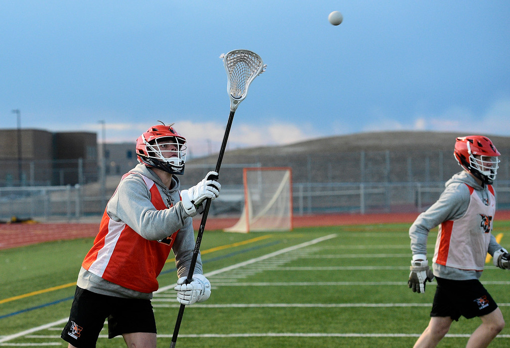 . ERIE CO: February 28, 2019:   Aiden Abram during Erie lacrosse practice on Thursday. Erie High School is one of the new programs in lacrosse this upcoming spring. (Photo by Cliff Grassmick/Staff Photographer)